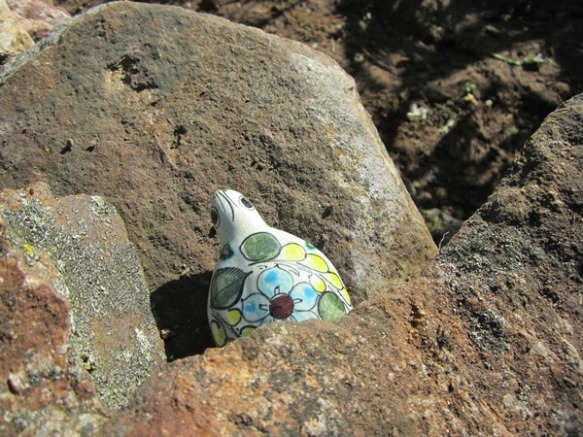 "random garden art--this little turtle sits on a rock on the ""strawberry bed""--I forget where it came from."